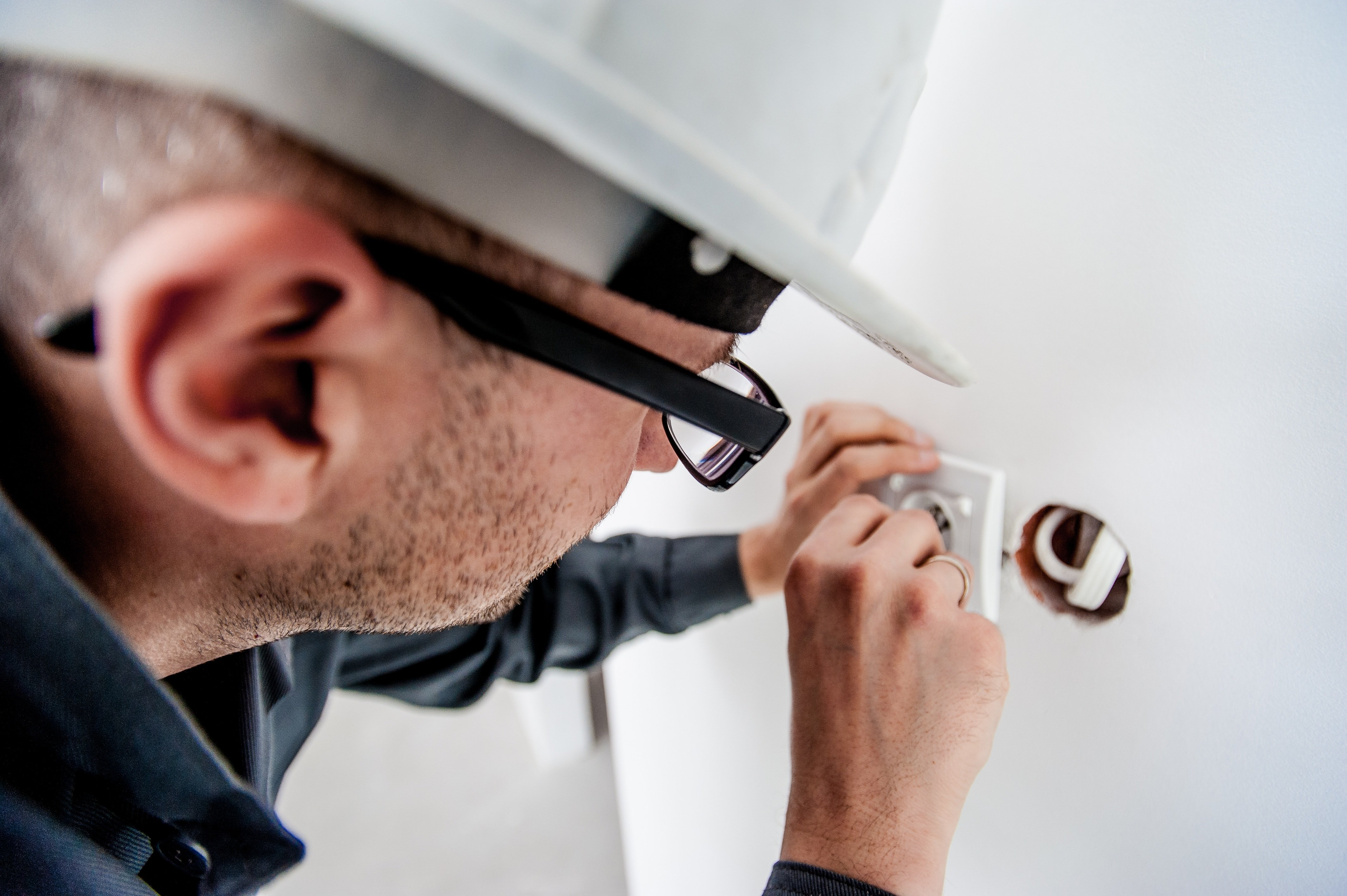 electrician fixing socket in house